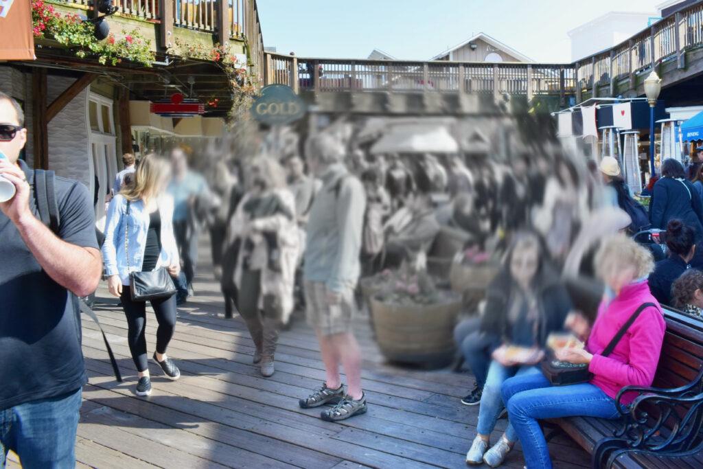 Et billede af mennesker med et sløret grå punkt it midten der indikerer hvordan man ser med AMD - AMD